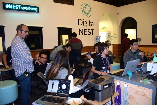 Jacob Martinez (left) in the co-working space at the Digital NEST.
