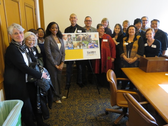 Board of Supervisors member, Malia Cohen (left of poster) and other supporters first presented the idea for the Dignity Fund last year, at this Board of Supervisors' meeting. Photo courtesy of the Dignity Fund.