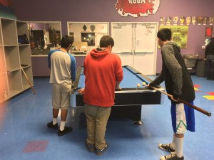 Teens play pool at the Boys and Girls Club of Greater Oxnard and Port Hueneme's Teen Center in Oxnard. Teens on probation who are enrolled in the Evening Reporting Center mingle with regular kids who attend the club.