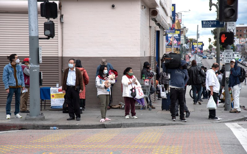 A crowd of people wearing face masks in Los Angeles during COVID-19 face masks in Los Angeles