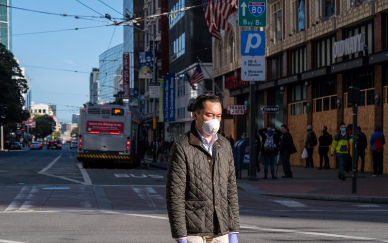 A man crosses Market Street in San Francisco last April during the pandemic. Photo by Philip Wyers / iStock