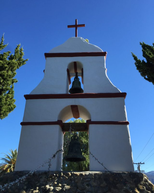 The bell tower at San Antonio de Pala with cactus.