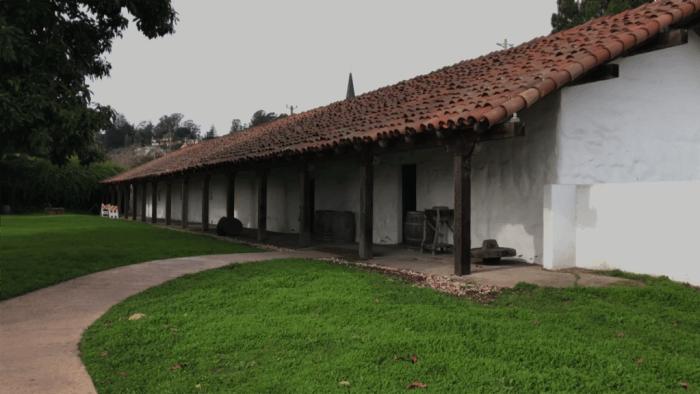 Restored native family housing at Mission Santa Cruz State Park.