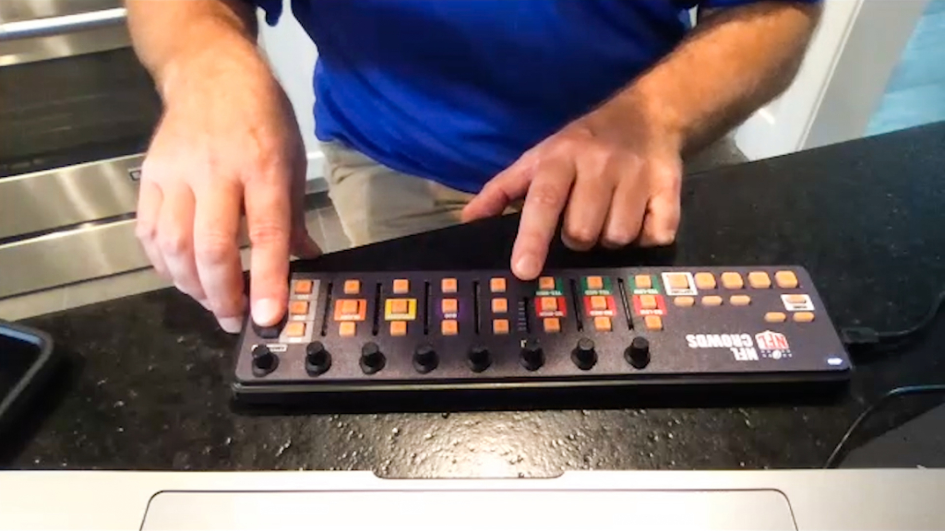 A man with his hands on a small electronic button controller