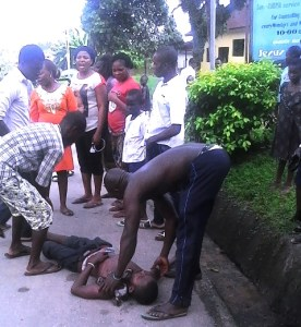 The victim, being carried to the hospital by sympathisers