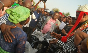 Boki LGA royal father (in red flowing cap) claps as Bisong hands out a motorcycle to a beneficiary