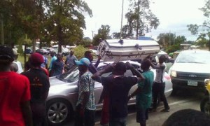 The supporters with the casket at the airport