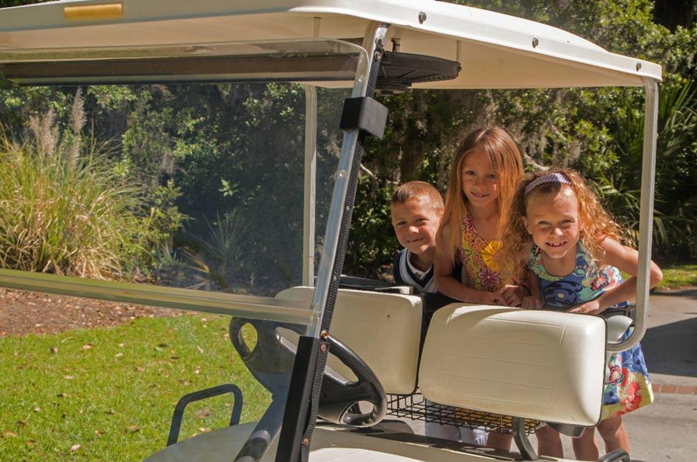 Image result for kids on golf carts
