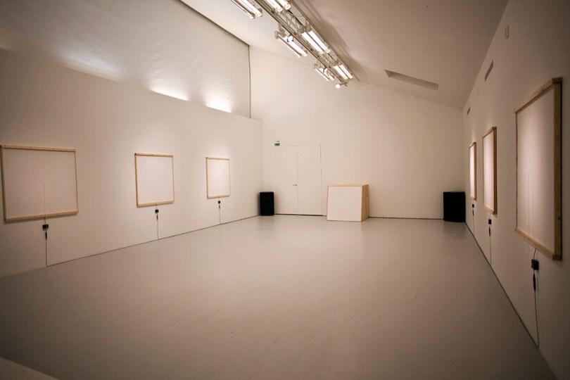 Picture of the room where all of the white boxes are intact.