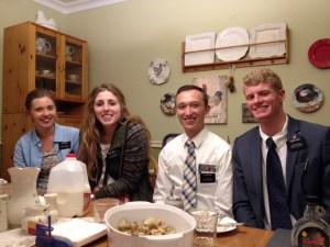 Sister Call with other missionaries at a member's home