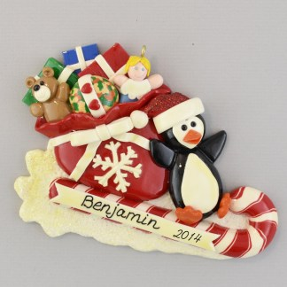 Penguin on Toboggan with Bag of Toys personalized Christmas Ornaments