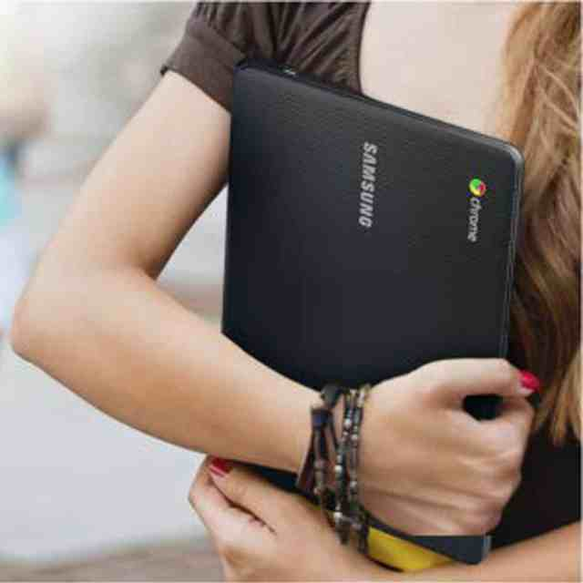 A woman holds a laptop in your lap which is a symbol of love for Best New Laptops