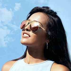Woman with wearing a sunglass, the sign of the best sunglasses for women