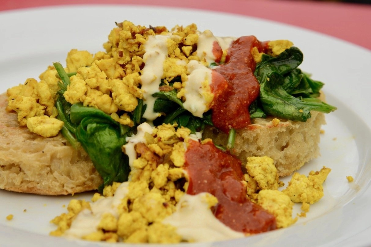 Seriously good tofu scramble on toast with hollandaise, spinach and salsa