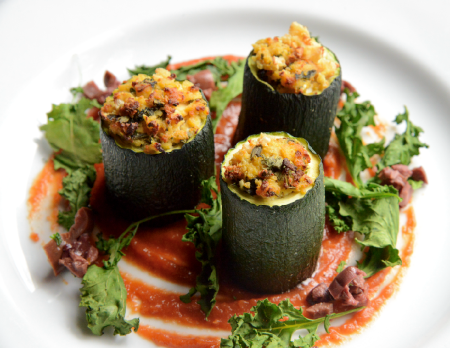 Zucchini Cannelloni with romato red pepper puree and kale and olive garnish