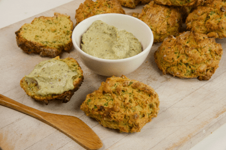 Serving board with Savoury Drop Biscuits and pesto cream cheese