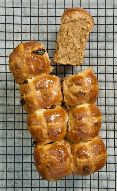 Loaf of Hot Cross Brioche on a cake rack