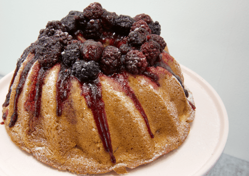 Apple cake decorated with blackberries