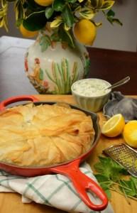 Wild green pie with tzatziki, fresh lemons and herbs