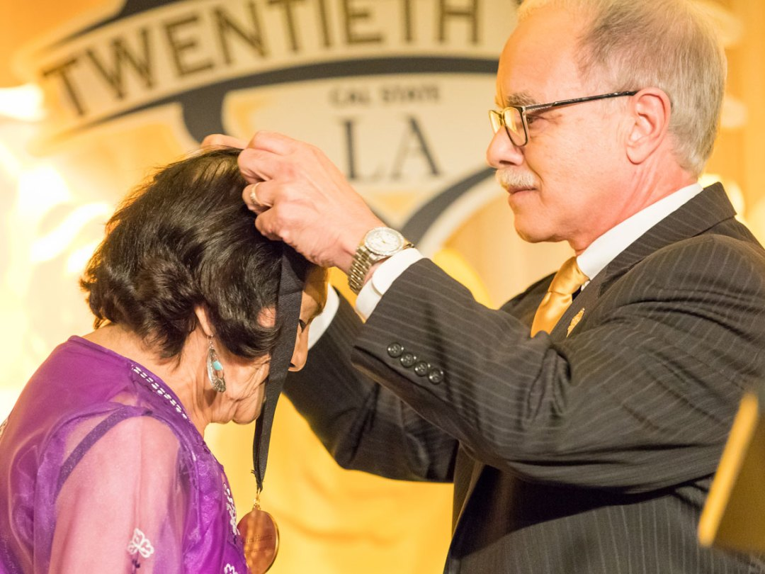 Dolores Huerta receiving the Presidential Medallion from President Covino at the 20th Billie Jean King & Friends Gala