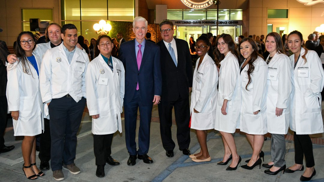 State Sen. Robert M. Hertzberg (center right) and former Gov. Gray Davis (center left) with students in the Hertzberg-Davis Forensic Science Center