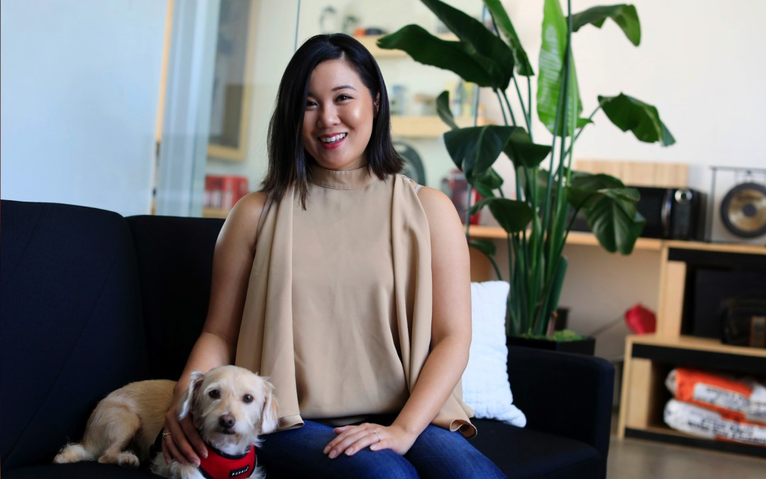 Mylen Yamamoto and her dog sitting on a couch.