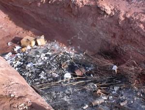Industrial Waste Disposal Burn Pit Observed During RCRA Audit Inspection