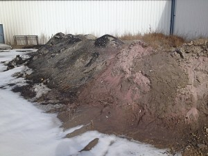 Oil Contaminated Waste Pile Discovered During Phase 1 Onsite Inspection