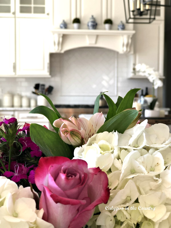 Spring flowers in white kitchen