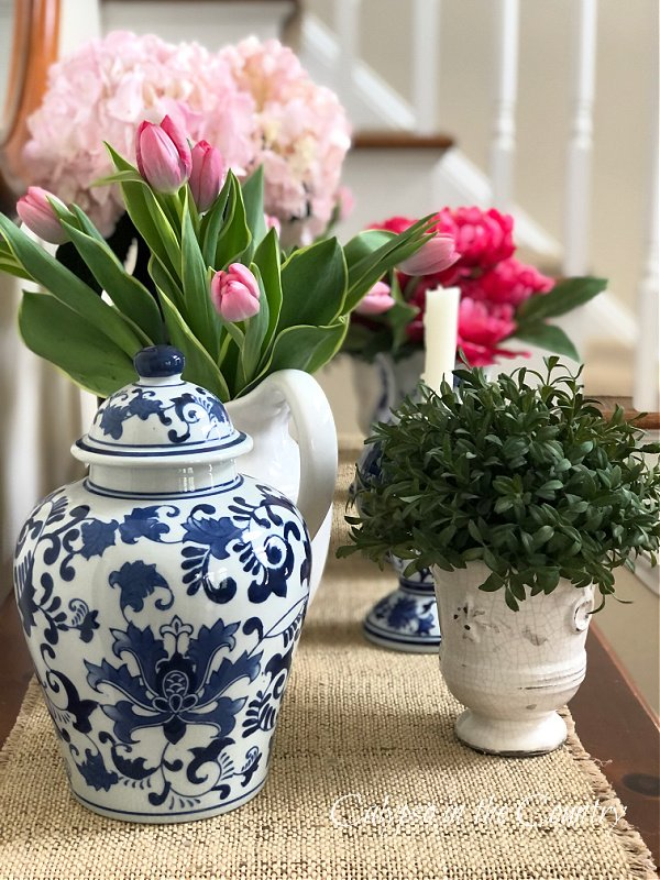 Blue and white porcelain and flowers on table - how to decorate an entry table for spring