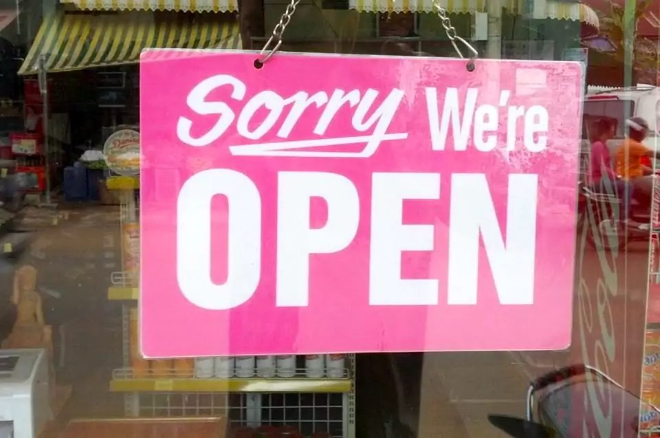 signage : sorry were open