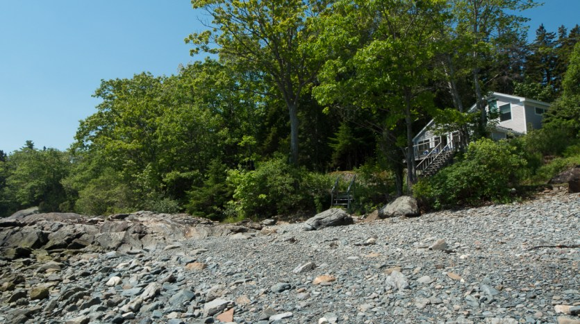 Rocky beach and cottage