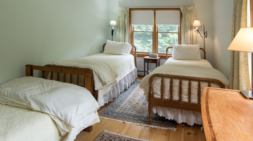 Smaller side bedroom with 3 twin beds