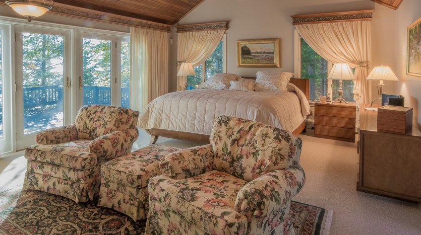 Master bedroom with sitting area and deck access