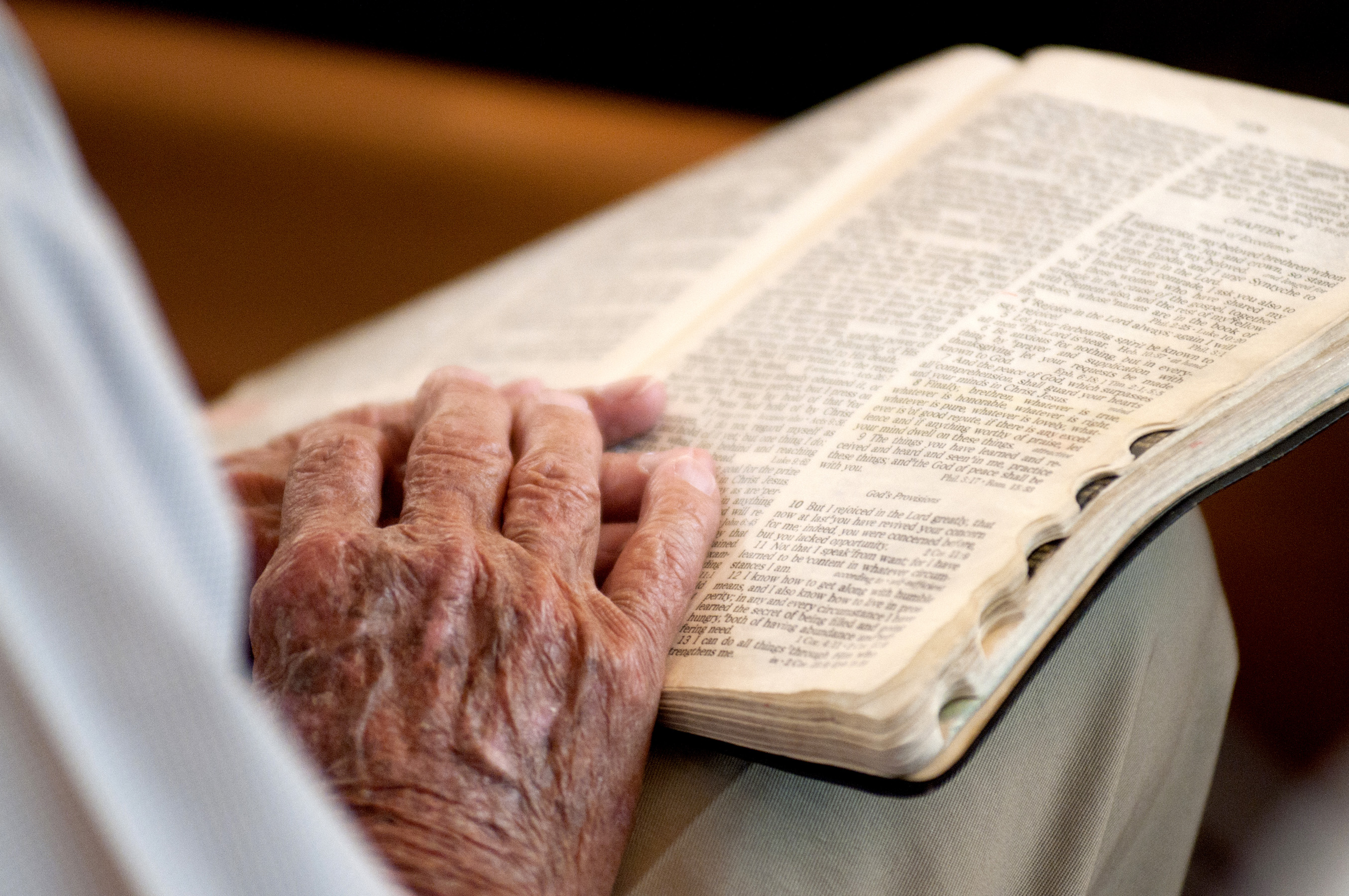 Image result for hands on a bible images