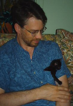 Brent with kitten in his pocket, photo by Lorelle VanFossen
