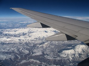 flight oregon to alabama out window of airplane mountains snow by brent vanfossen