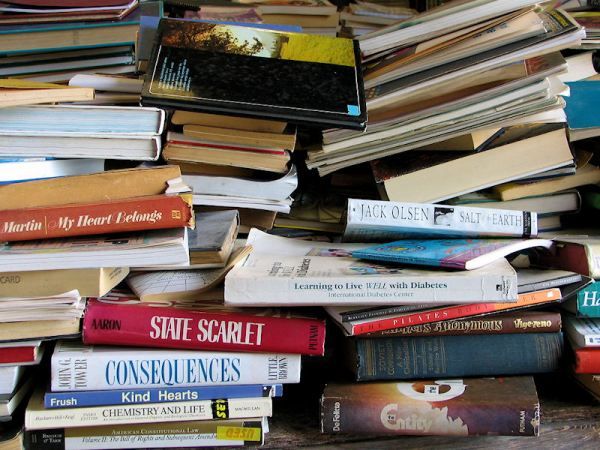 stack of used books, by Lorelle VanFossen