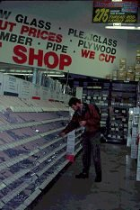 At the hardware store, Brent shops for more trailer parts and bits, copyright Lorelle VanFossen 1996