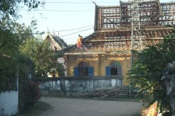 Monk cleening the roof at the Monastery
