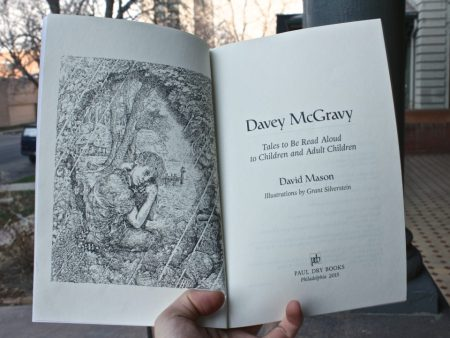 The book Davey McGravy open to its title page.