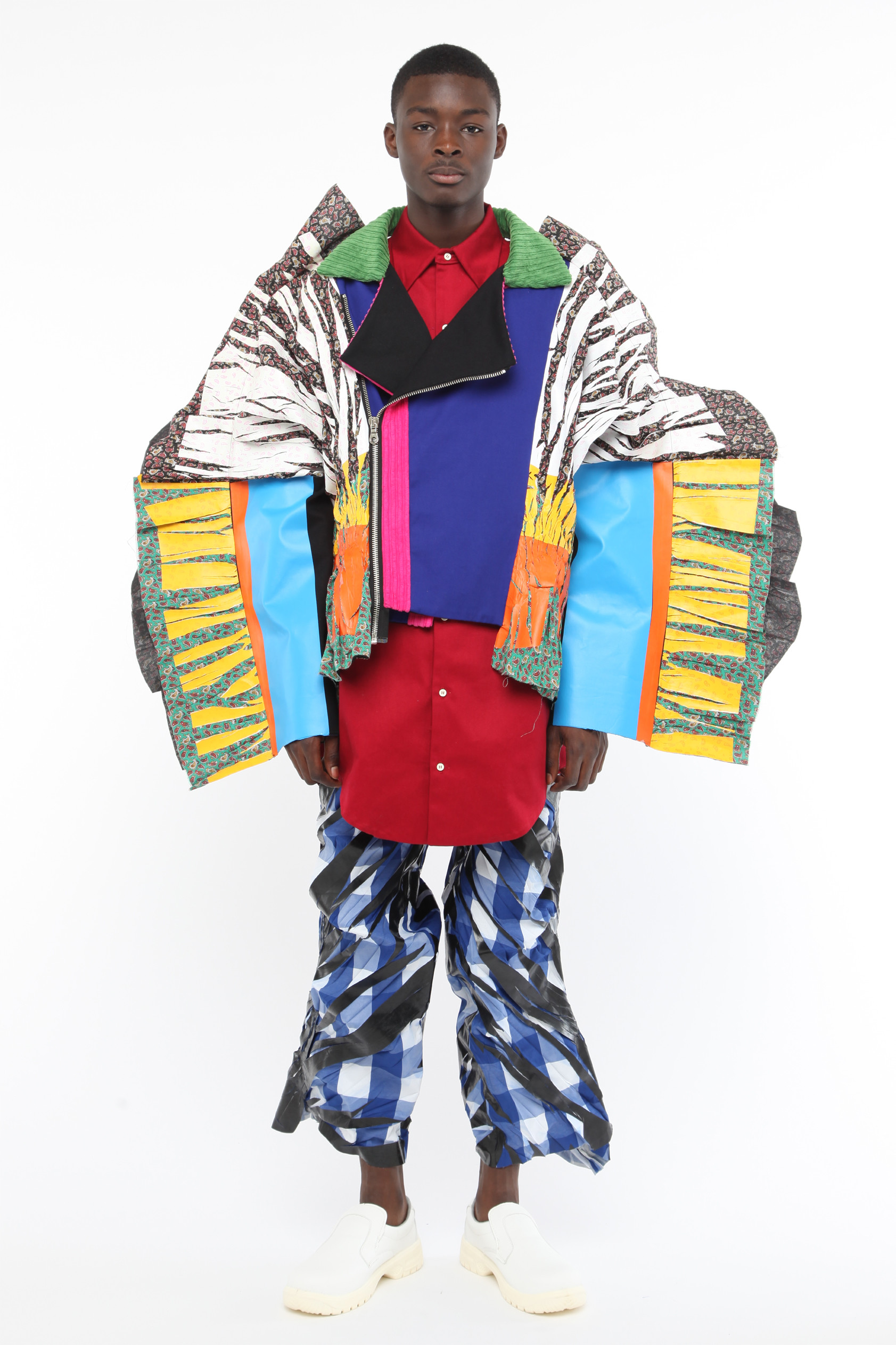 A model wears bright and oversized pants and a jacket design by Wataru Tominaga.