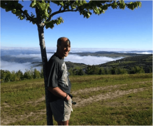 Douglas enjoying amazing views - in the mountain top above the clouds