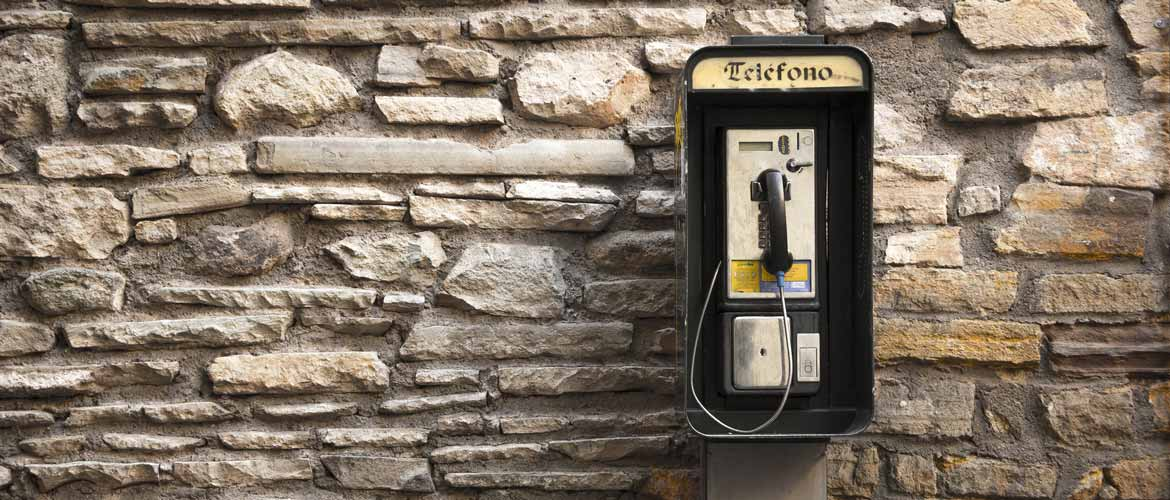 Old stylish Spanish Telephone on brick wall