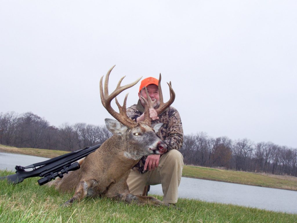 Deer hunter with a prized whitetail