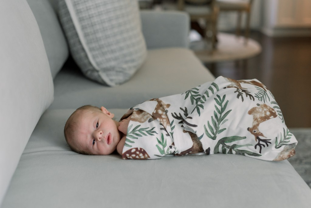 baby swaddled in baby deer blanket