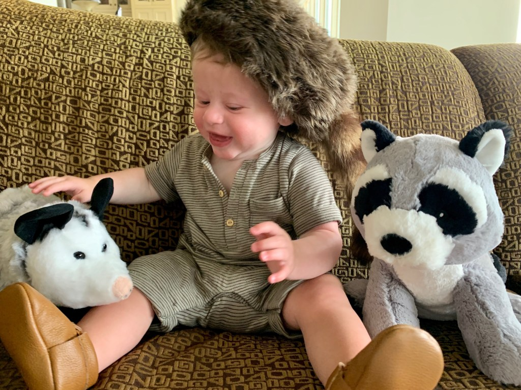baby with stuffed animals