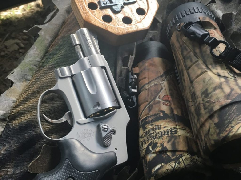 My favorite gear when hunting turkeys- handgun, binoculars, and a slate call!
