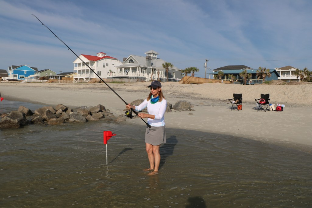 girl surfishing in Garden City, South Carolina