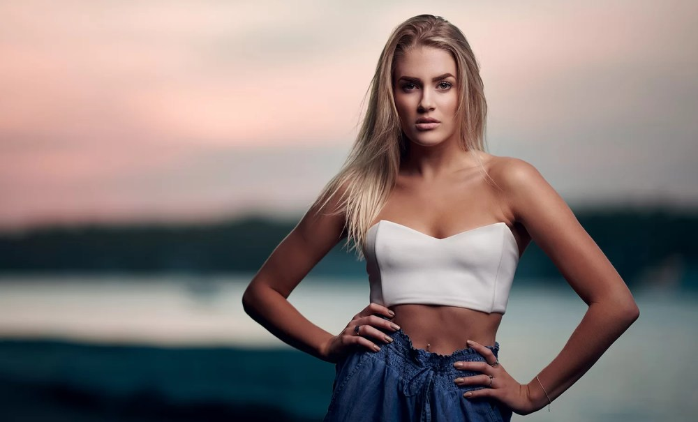 best camera settings for shooting with strobes woman at sunset
